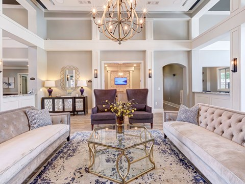 Stunning community lounge with coffee bar, chandelier and plush seating